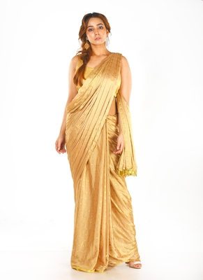 beige colour blended chiffon saree with golden fringe lace pallu