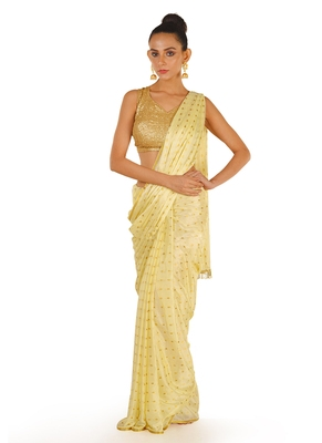 offwhite color blended chiffon saree with golden fringe lace pallu