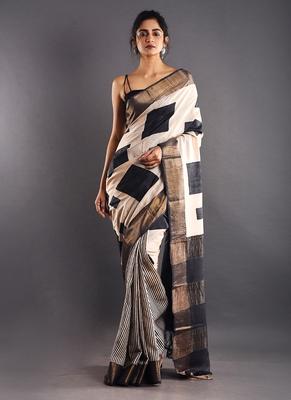offwhite & black tussar silk saree with golden zari border