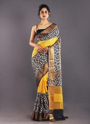 yellow & black tussar silk saree with zari border