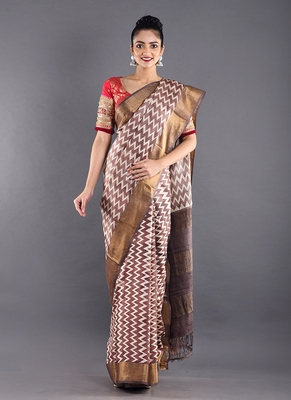 beige and brown tussar silk saree with zari border
