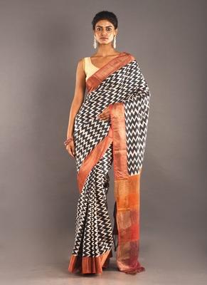 beige tusser silk saree with zig zag motif & zari border