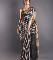 Black & White Tussar Silk Saree With Zari Border