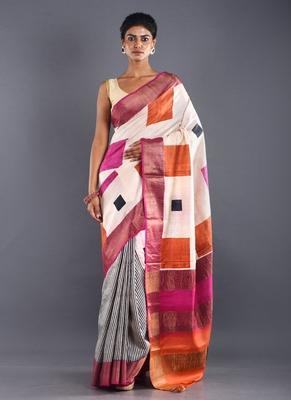 beige tussar silk saree with geometrical motif & zari border