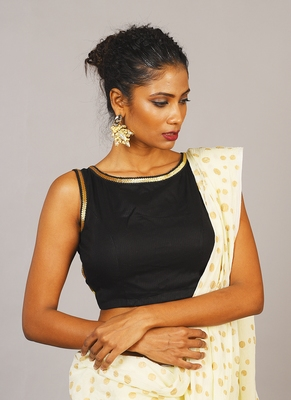 black boat neck sleaveless blouse with golden sequin lace