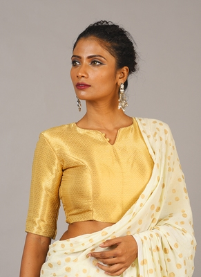 golden blouse with brooch