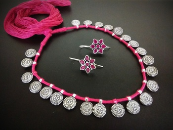pink tassle coin interlaced set with kundan earring