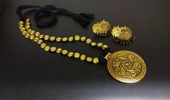 black tassle Golden tone round pendant with black pearl jhumka