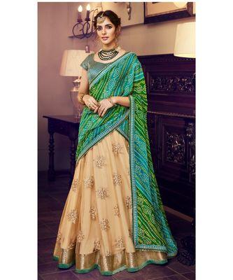 Tussar Color Net Lehenga With Green Handloom Choli And Green Bandhani Colour Georgette Dupatta