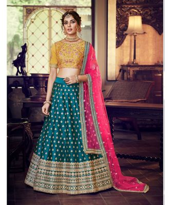 Peacock Blue Colour Satin Silk Lehenga With Mustard Colour Handloom Silk Choli And Pink Colour Net Dupatta