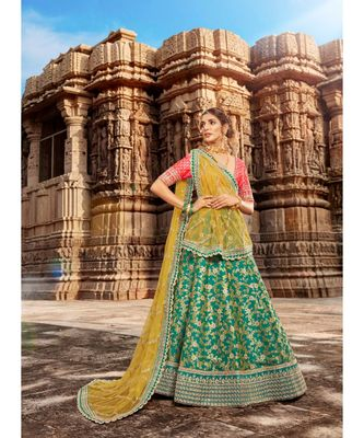 Ferozi Colour Jacquard Lehenga With Rani Colour Jacquard Choli And Yellow Colour Net Dupatta