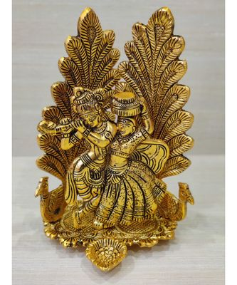 Golden Oxidized Antique Look Metallic Lord Radha Krishna Idol With Diya And Peacock In Background