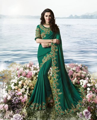 Teal embroidered silk blend saree