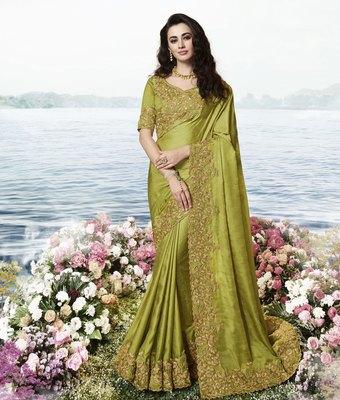 Green embroidered silk blend saree