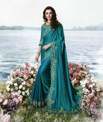 Teal embroidered silk blend saree