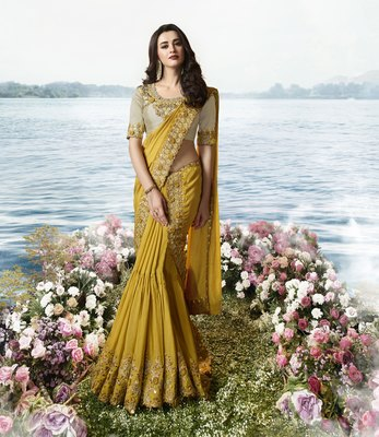 Mustard embroidered silk blend saree
