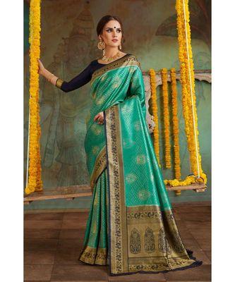 Teal green woven Banarasi Kataan saree with blouse