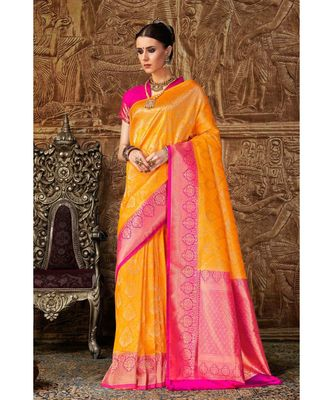 Bright yellow woven Banarasi Kataan saree with blouse