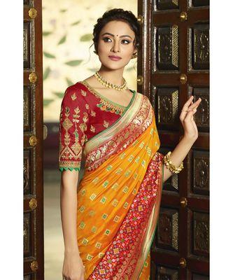 Mustard yellow designer banarasi Patola fusion saree with embroidered silk blouse