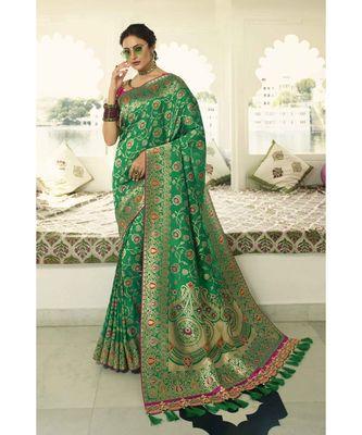 Green designer banarasi saree with embroidered silk blouse