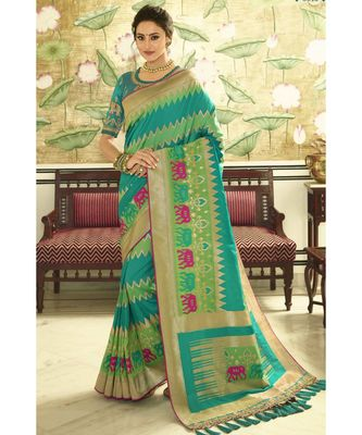 Teal blue designer banarasi patola fusion saree with embroidered silk blouse