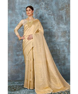 Subtle gold woven kanjivaram saree with blouse