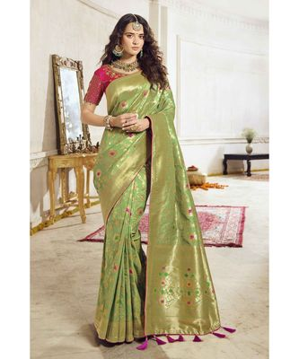 Pastel green woven designer banarasi saree with embroidered silk blouse