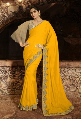 Yellow embroidered fancy fabric saree with blouse
