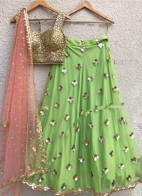 Green plain net unstitched lehenga