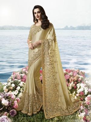 Dark cream embroidered pure tissue saree with blouse