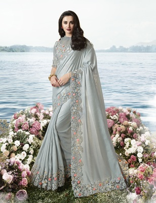 Grey embroidered pure tissue saree with blouse