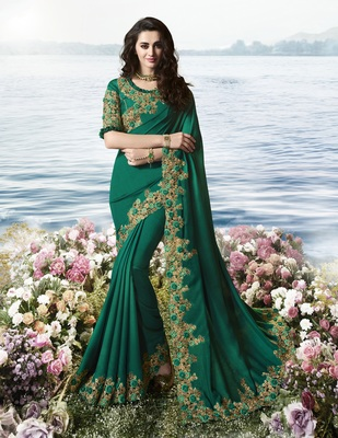 Dark teal embroidered pure silk saree with blouse