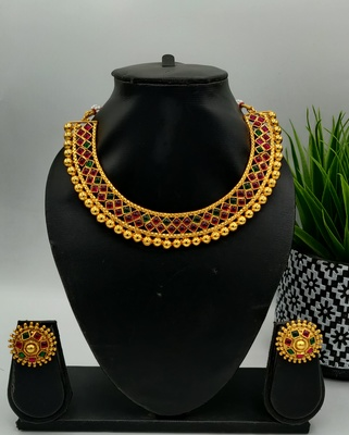 Red And Green Stone Studded Metallic Neckalce Sets