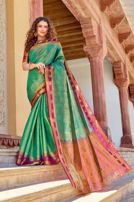 Sea green woven silk saree with blouse