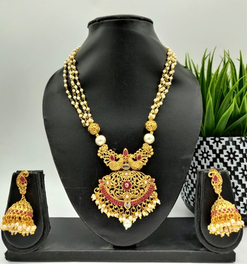 Gold plated with red stone studded and white moti neckalce set for women
