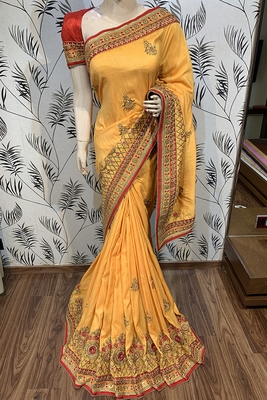 Yellow embroidered pure georgette saree with blouse