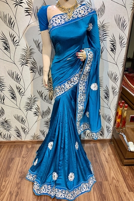 Blue embroidered pure silk saree with blouse