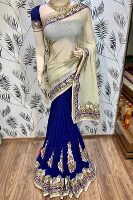 Cream embroidered pure silk saree with blouse