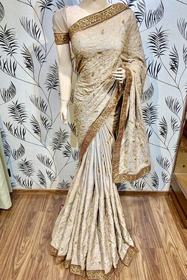 Light pink embroidered pure satin saree with blouse
