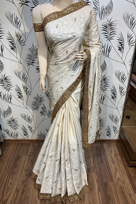 Off white embroidered pure satin saree with blouse