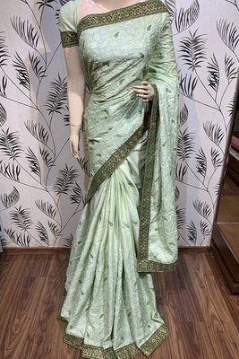 Light green embroidered pure satin saree with blouse