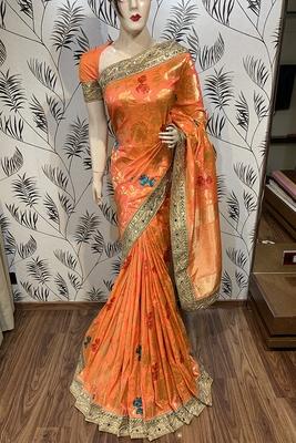 Orange embroidered pure banarasi silk saree with blouse