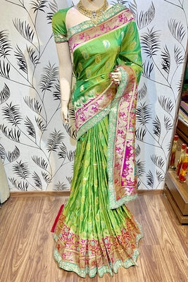 Green embroidered pure banarasi silk saree with blouse