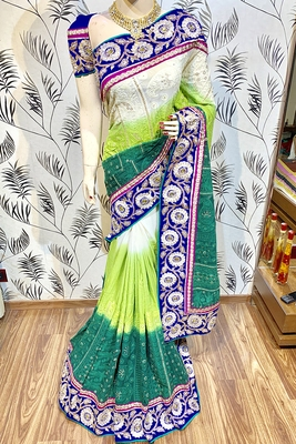 Green embroidered pure georgette saree with blouse