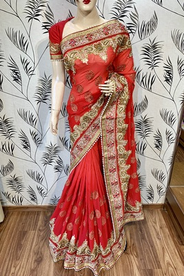 Red embroidered pure georgette saree with blouse