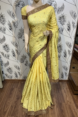 Yellow embroidered pure satin saree with blouse