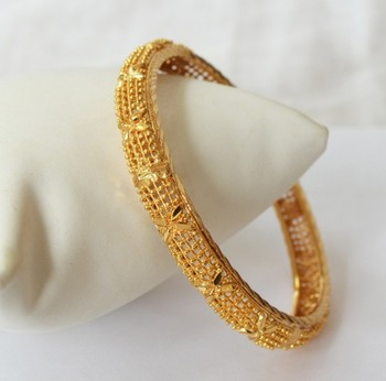 Gold plated bangle with mesh design