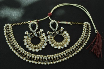 Kundan Necklace with Pearls & Black stones & Long Round Earrings with Black peacock moti, pearls and white stones