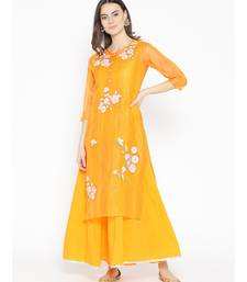 yellow embroidered chanderi kurtis