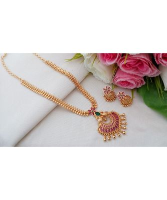 Trendy Gold Tone Necklace with Peacock Pendant made out from Ruby Emerald Stones and Matching Jhumkas